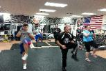 Kickboxing class personal trainer, Martin, warming up the group