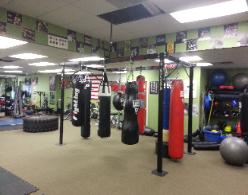 pic of personal training studio/ gym, heavy bags from boxing class, best way to lose weight