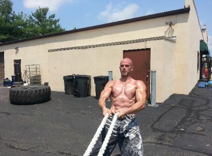 Personal trainer working out in Nanuet studio, gym with battle ropes and prowler sled, in Rockland County