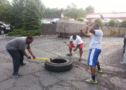 outdoor bootcamp classes, drills, exercises and workouts  tire flips, sledgehammer