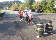 Outdoor Partner workouts, Battle ropes prowler sled exercises during Boot Camp conditioning in Nanuet Gym