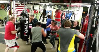 Boxing Class Heavy Bag punch drills during Cardio Workout in Rockland county gym