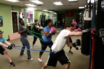 Heavy bag boxing work out punch drills in Nanuet gym