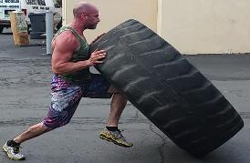Personal Trainer Workout Outdoors of Rockland County gym, Owner Steve tire flips