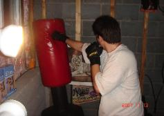 Hitting the heavybag during Boxing class in Rockland county, Boot Camp